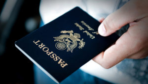 Passport in hand. You can get a passport in one day.